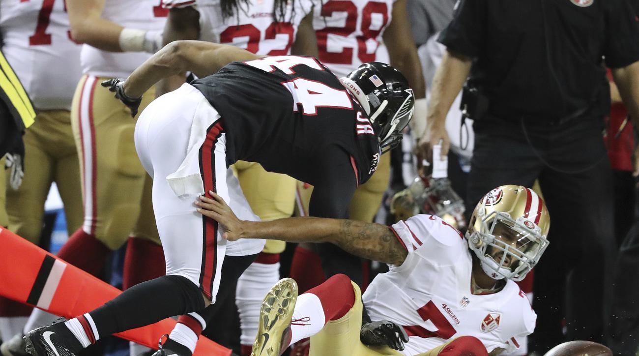 Atlanta Falcons Vic Beasley Jr., left, tackles San Francisco 49ers quarterback Colin Kaepernick during the second quarter of an NFL football game, Sunday, Dec. 18, 2016 in Atlanta. (Curtis Compton/Atlanta Journal-Constitution via AP)