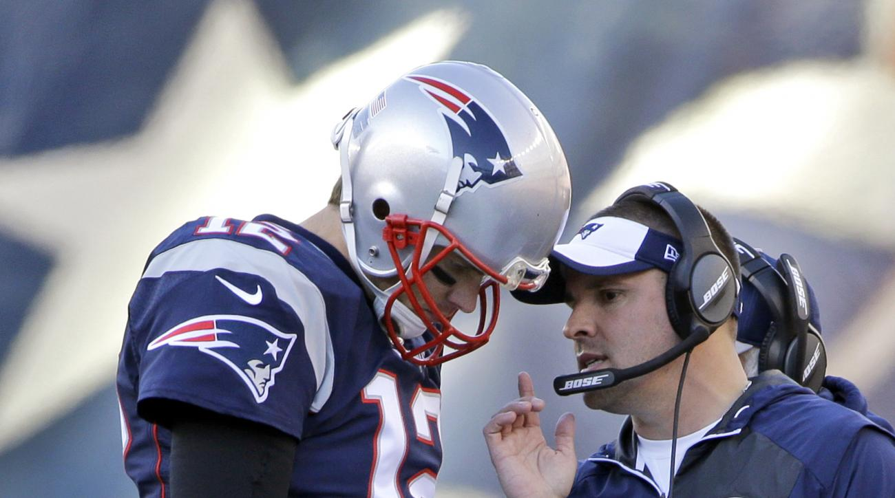 FILE - In this Dec. 4, 2016, file photo, New England Patriots quarterback Tom Brady (12) confers with offensive coordinator Josh McDaniels during the first half of an NFL football game against the Los Angeles Rams, in Foxborough, Mass. Patriots coordinato