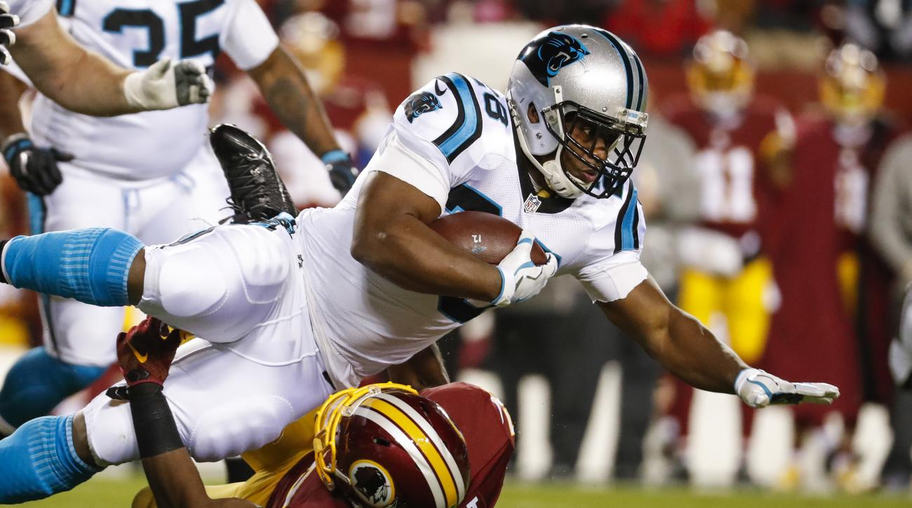 Carolina Panthers running back Jonathan Stewart (28) dives over Washington Redskins outside linebacker Martrell Spaight (50) during the first half of an NFL football game in Landover, Md., Monday, Dec. 19, 2016. (AP Photo/Alex Brandon)