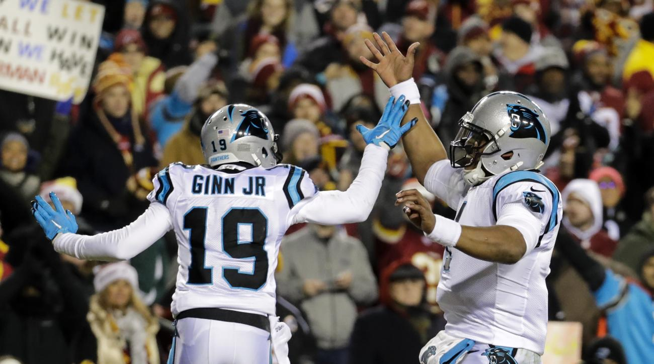 Carolina Panthers quarterback Cam Newton (1) celebrates wide receiver Ted Ginn's (19) touchdown reception during the first half of an NFL football game against the Washington Redskins in Landover, Md., Monday, Dec. 19, 2016. (AP Photo/Patrick Semansky)