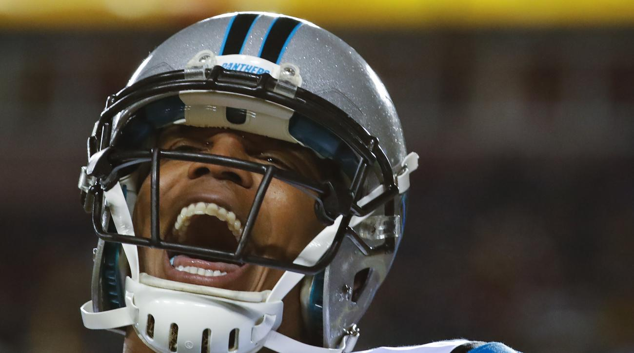 Carolina Panthers quarterback Cam Newton (1) celebrates wide receiver Ted Ginn's touchdown during the first half of an NFL football game against the Washington Redskins in Landover, Md., Monday, Dec. 19, 2016. (AP Photo/Alex Brandon)