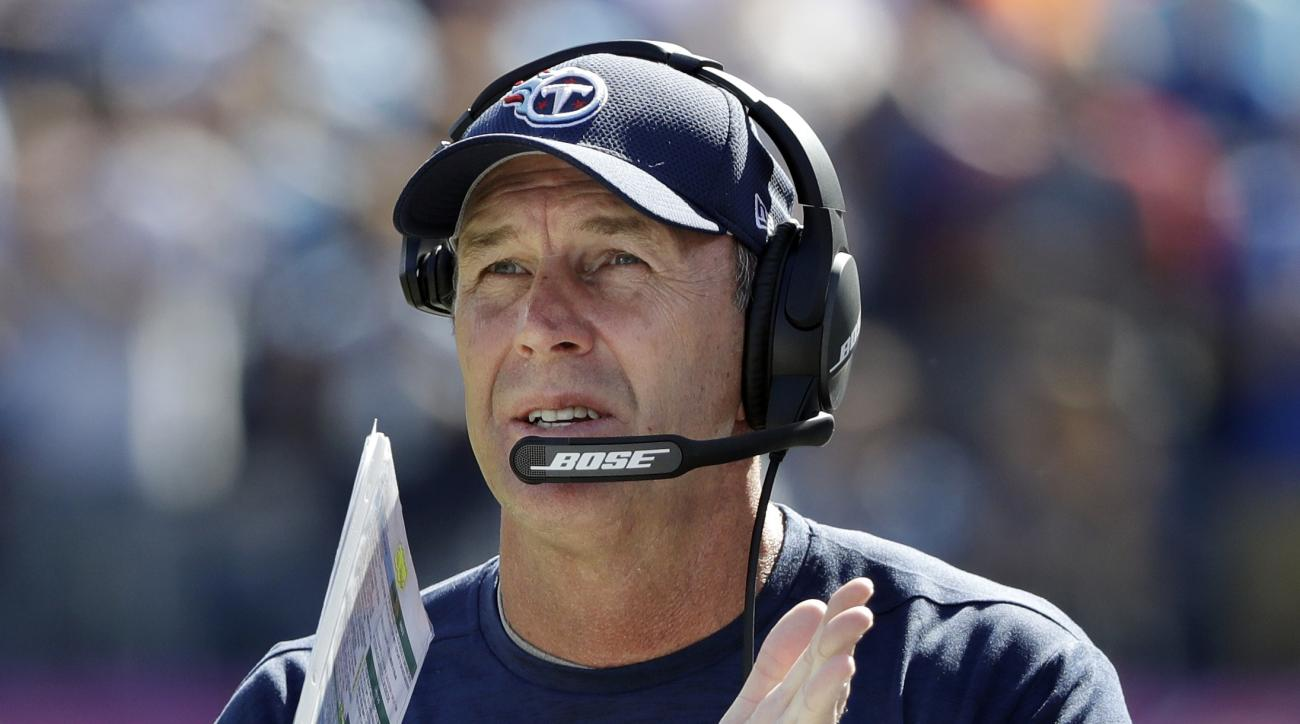 FILE - In this Oct. 23, 2016, file photo, Tennessee Titans head coach Mike Mularkey applauds a play in the first half of an NFL football game against the Indianapolis Colts in Nashville, Tenn. His confidence has filtered through the Titans who are poised