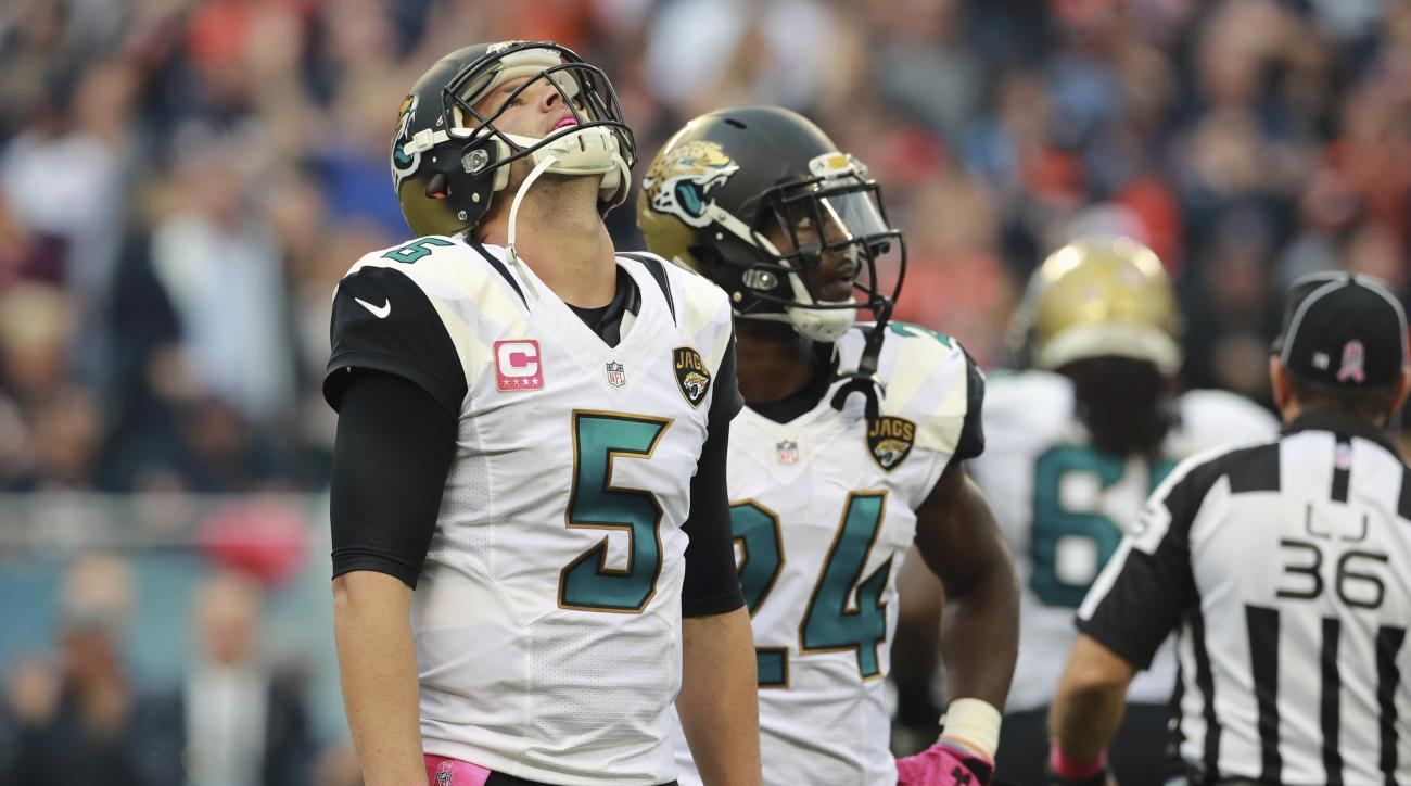 FILE - In this Oct. 16, 2016, file photo, Jacksonville Jaguars quarterback Blake Bortles (5) reacts after fumbling the ball against the Chicago Bears during an NFL football game in Chicago. The Jaguars (2-12) have a chance to reach another low by failing
