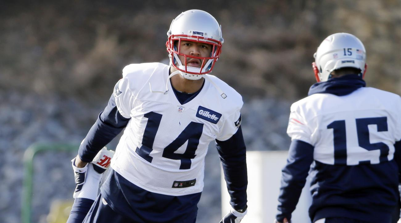 New England Patriots wide receiver Michael Floyd (14) stretches during an NFL football team practice Wednesday, Dec. 21, 2016, in Foxborough, Mass. (AP Photo/Elise Amendola)