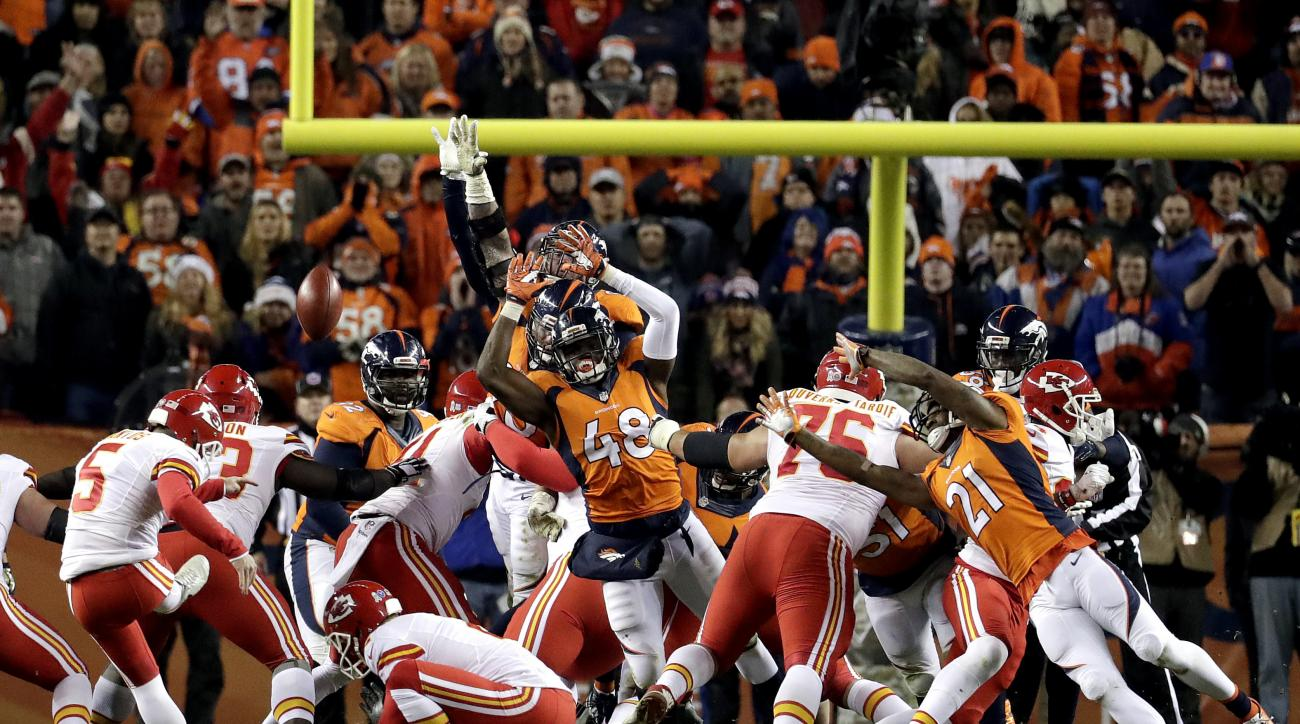 FILE -  In this Sunday, Nov. 27, 2016 file photo, Kansas City Chiefs kicker Cairo Santos (5) kicks the game winning field goal as punter Dustin Colquitt (2) holds during overtime of an NFL football game against the Denver Broncos in Denver. The Denver Bro