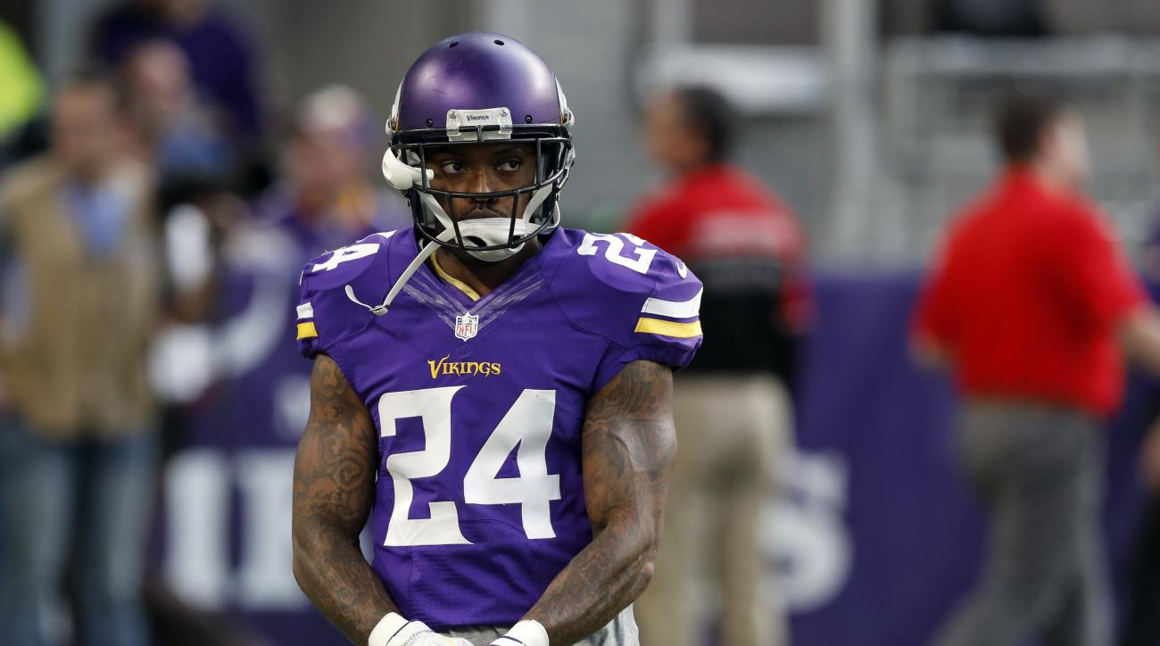 FILE - In this Dec. 18, 2016 file photo, Minnesota Vikings cornerback Captain Munnerlyn warms up before the start of an NFL football game between the Indianapolis Colts and the Minnesota Vikings, in Minneapolis. The fortunes of the Vikings and Green Bay P