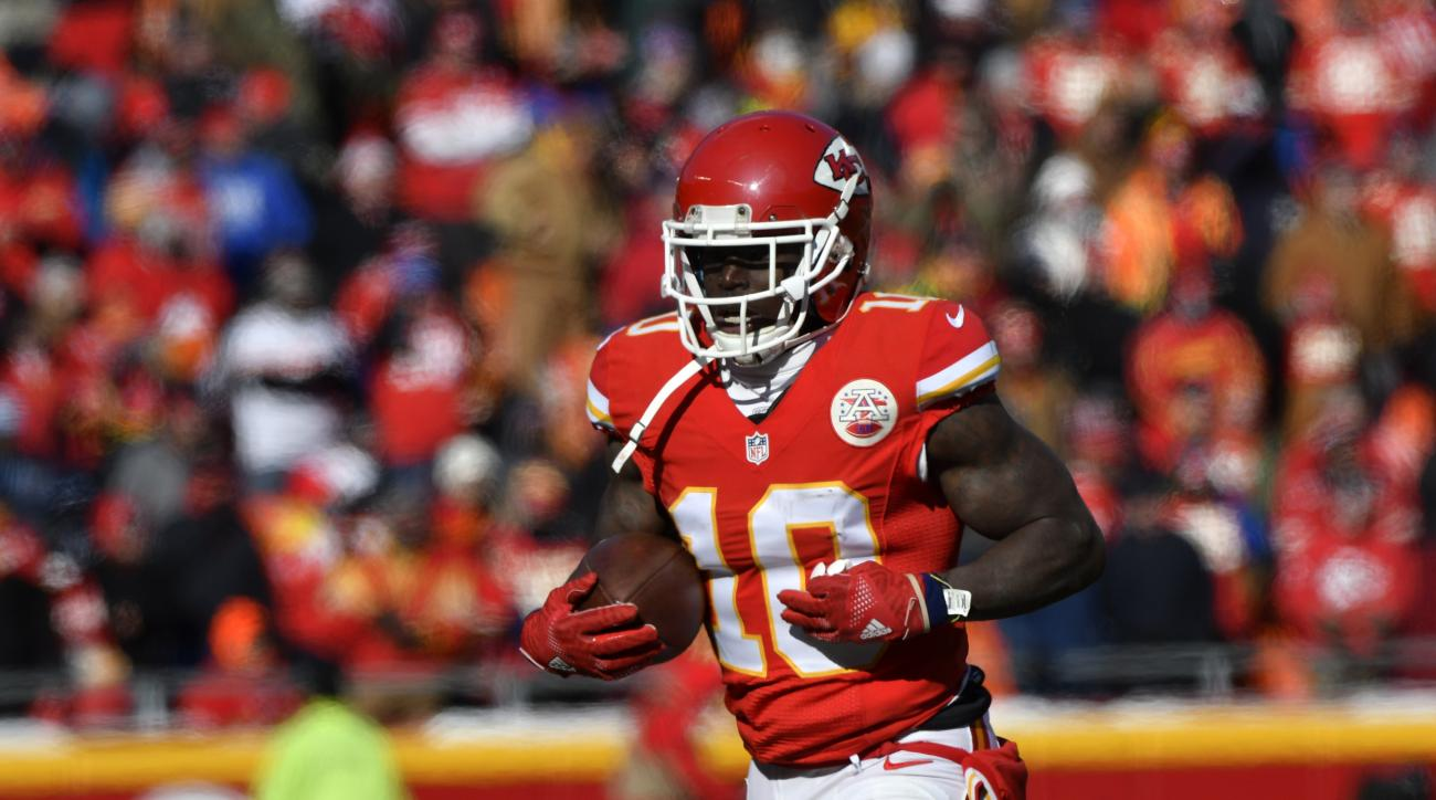 FILE - In this Dec. 18, 2016 file photo, Kansas City Chiefs wide receiver Tyreek Hill (10) holds the ball after he scored a touchdown on a 68-yard rush, during the first half of an NFL football game against the Tennessee Titans in Kansas City, Mo. The Chi