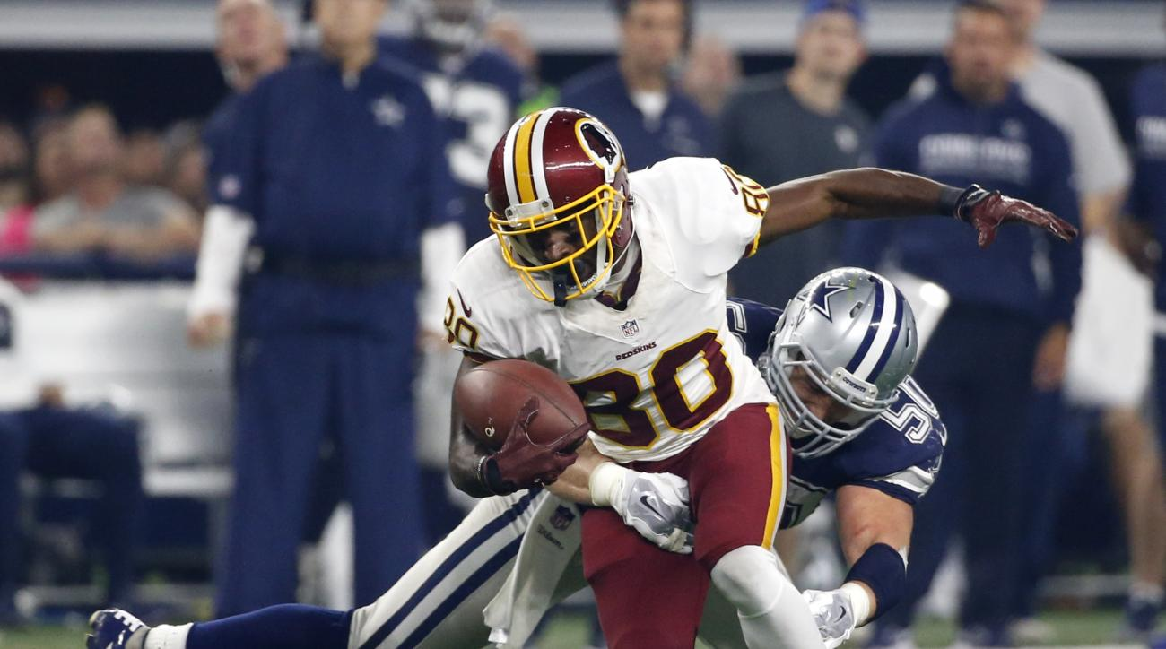 FILE - In this Thursday, Nov. 24, 2016 file photo, Washington Redskins wide receiver Jamison Crowder (80) attempts to escape a tackle by Dallas Cowboys' Sean Lee (50) during the second half of an NFL football game in Arlington, Texas. This has not been th
