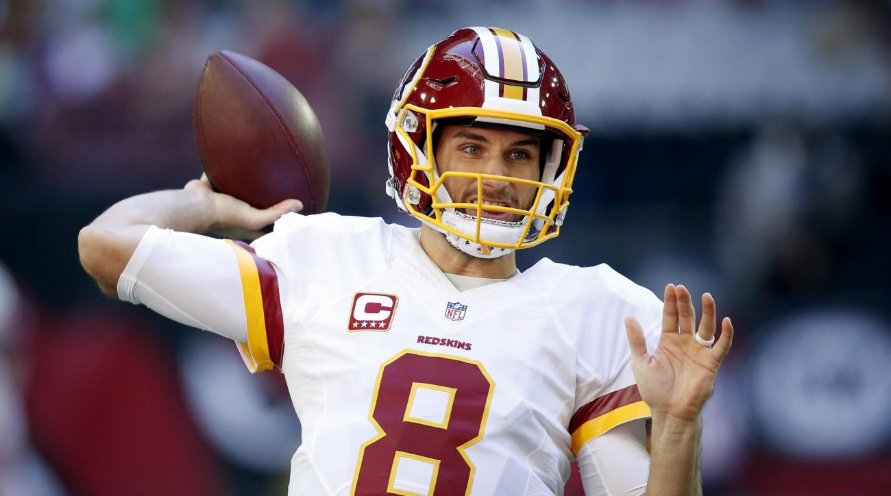 FILE - In this Sunday, Dec. 4, 2016, file photo, Washington Redskins quarterback Kirk Cousins (8) warms up prior to an NFL football game against the Arizona Cardinals in Glendale, Ariz. The Redskins play the Chicago Bears on Saturday, Dec. 24. (AP Photo/R