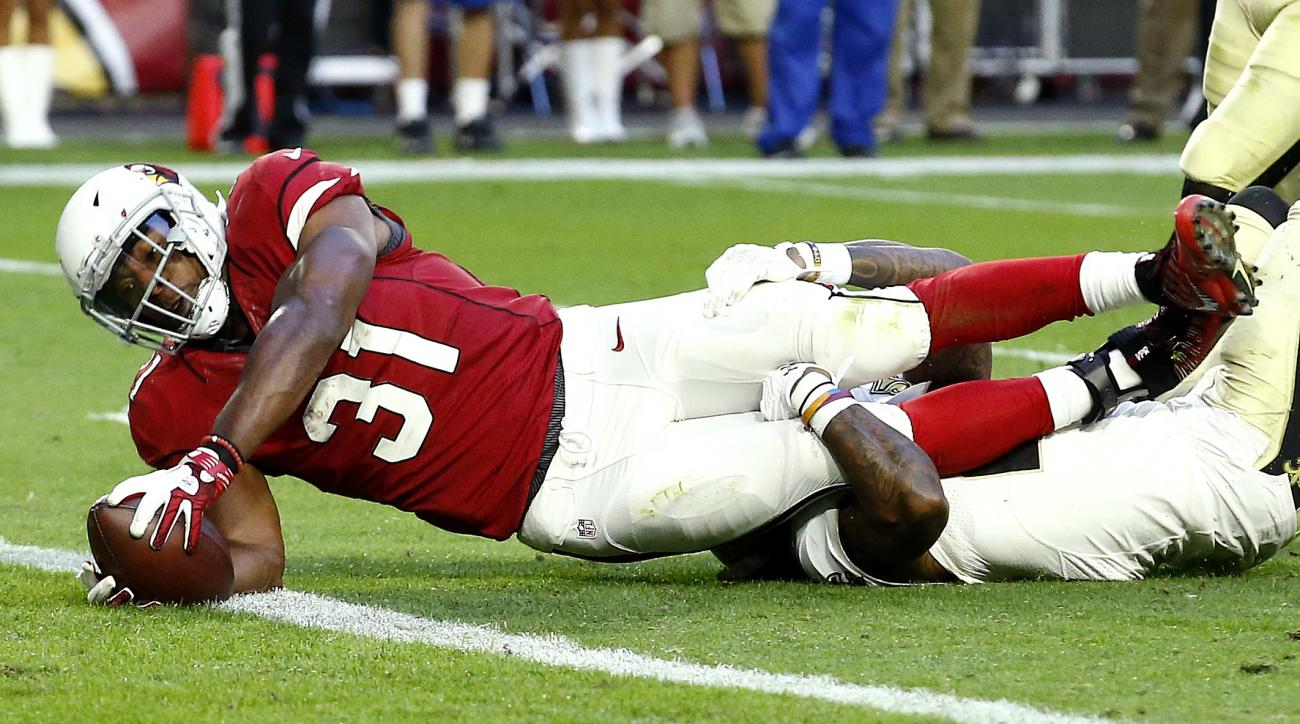 FILE - In this Dec. 18, 2016 file photo, Arizona Cardinals running back David Johnson (31) scores a touchdown as New Orleans Saints cornerback B.W. Webb defends during the second half of an NFL football game, in Glendale, Ariz. The Seattle Seahawks will h