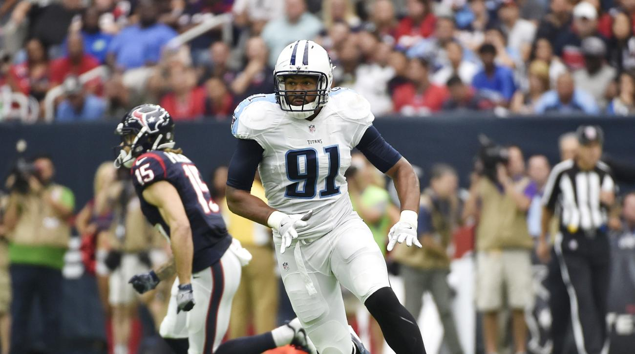 FILE - In this Sunday, Oct. 2, 2016 file photo, Tennessee Titans outside linebacker Derrick Morgan (91) runs during the first half of an NFL football game against the Houston Texans in Houston. he Tennessee Titans are on the verge of a record-tying turnar