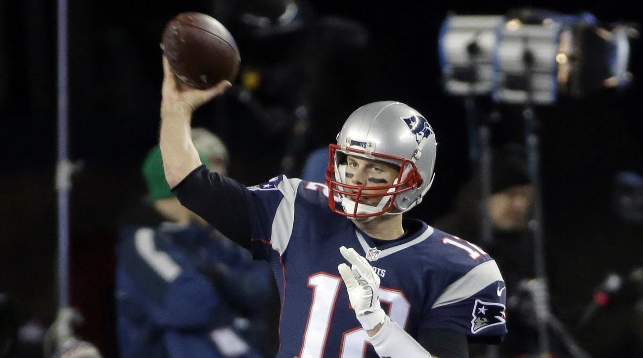 FILE - In this Dec. 12, 2016, file photo, New England Patriots quarterback Tom Brady warms up before an NFL football game against the Baltimore Ravens in Foxborough, Mass. New England tripped into the playoffs last season following an overtime loss at New