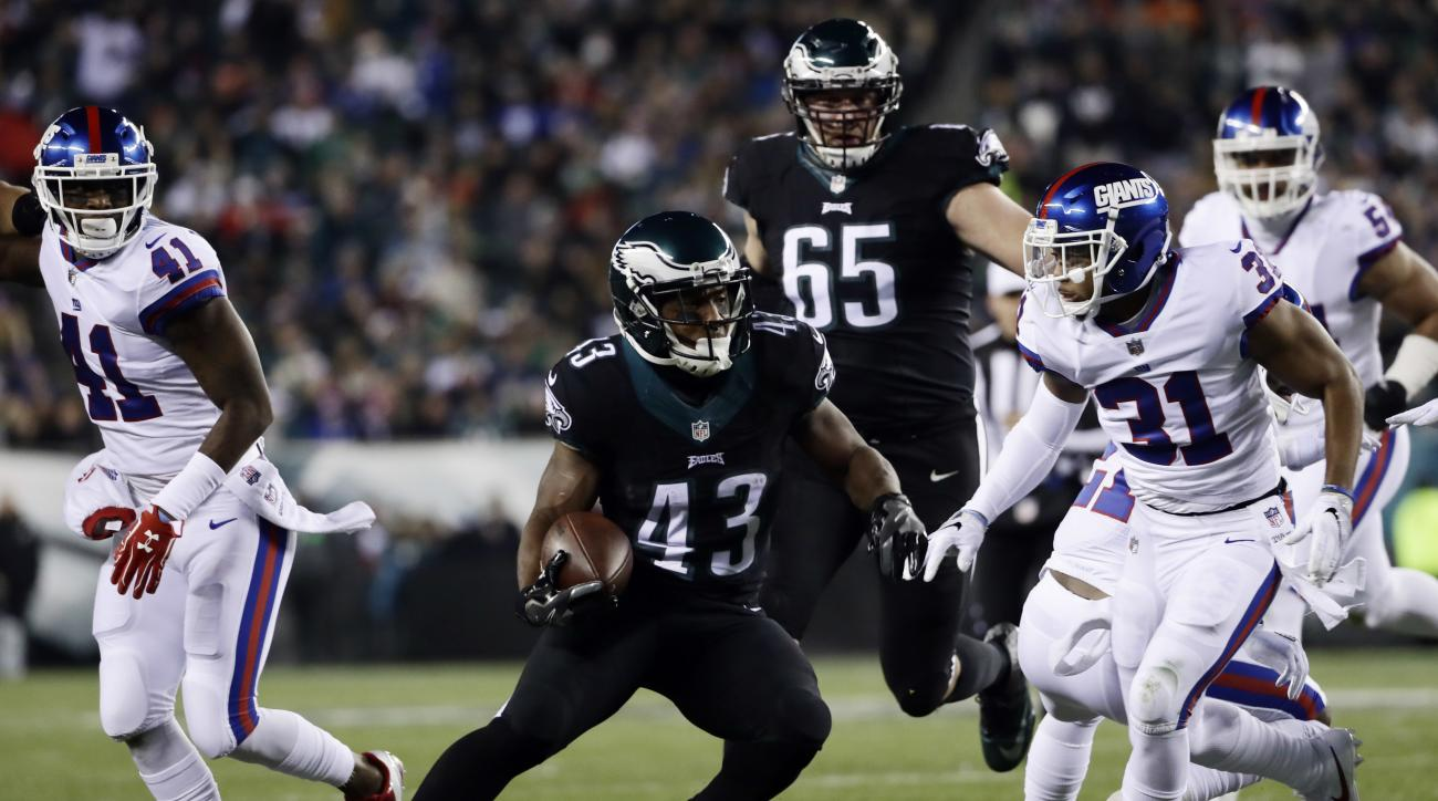 Philadelphia Eagles' Darren Sproles (43) rushes for a touchdown during the first half of an NFL football game against the New York Giants, Thursday, Dec. 22, 2016, in Philadelphia. (AP Photo/Michael Perez)