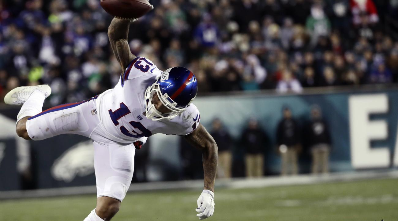 New York Giants' Odell Beckham (13) is sent flying after a hit by Philadelphia Eagles' Leodis McKelvin (21) during the second half of an NFL football game, Thursday, Dec. 22, 2016, in Philadelphia. (AP Photo/Michael Perez)