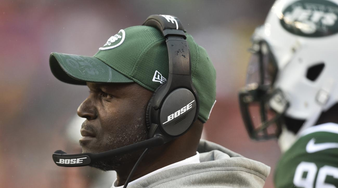 "FILE - In this Oct. 30, 2016, file photo, New York Jets coach Todd Bowles stands on the sideline during the team's NFL football game against the Cleveland Browns in Cleveland. Bowles has been hospitalized with what the team says is an ""undisclosed illness"