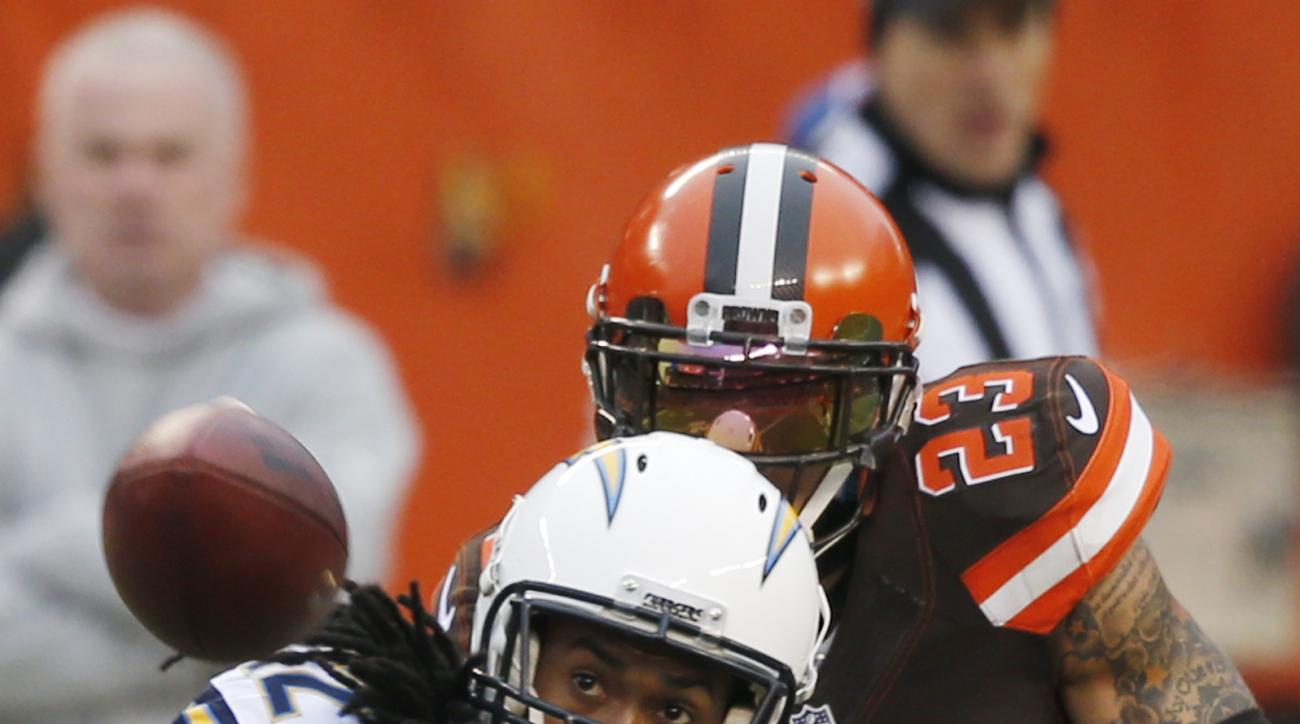 Cleveland Browns cornerback Joe Haden (23) breaks up a pass intended for San Diego Chargers wide receiver Travis Benjamin (12) in the first half of an NFL football game, Saturday, Dec. 24, 2016, in Cleveland. (AP Photo/Ron Schwane)
