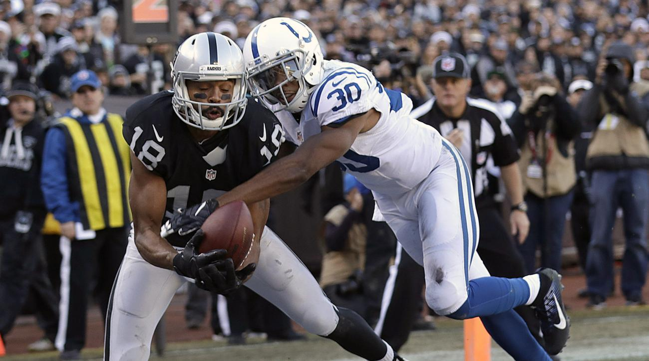 Oakland Raiders wide receiver Andre Holmes (18) catches a touchdown pass against Indianapolis Colts cornerback Rashaan Melvin (30) during the first half of an NFL football game in Oakland, Calif., Saturday, Dec. 24, 2016. (AP Photo/Marcio Jose Sanchez)