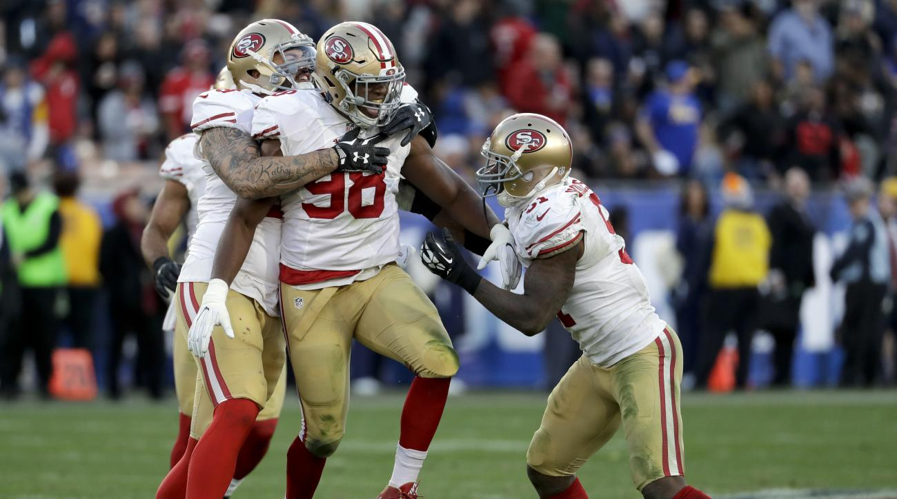 San Francisco 49ers defensive end Ronald Blair (98) celebrates after sacking Los Angeles Rams quarterback Jared Goff during the second half of an NFL football game Saturday, Dec. 24, 2016, in Los Angeles. (AP Photo/Rick Scuteri)