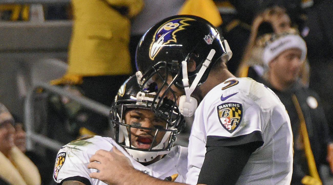 Baltimore Ravens wide receiver Steve Smith (89) celebrates with quarterback Joe Flacco after a touchdown during the second half of an NFL football game against the Pittsburgh Steelers in Pittsburgh, Sunday, Dec. 25, 2016. (AP Photo/Don Wright)
