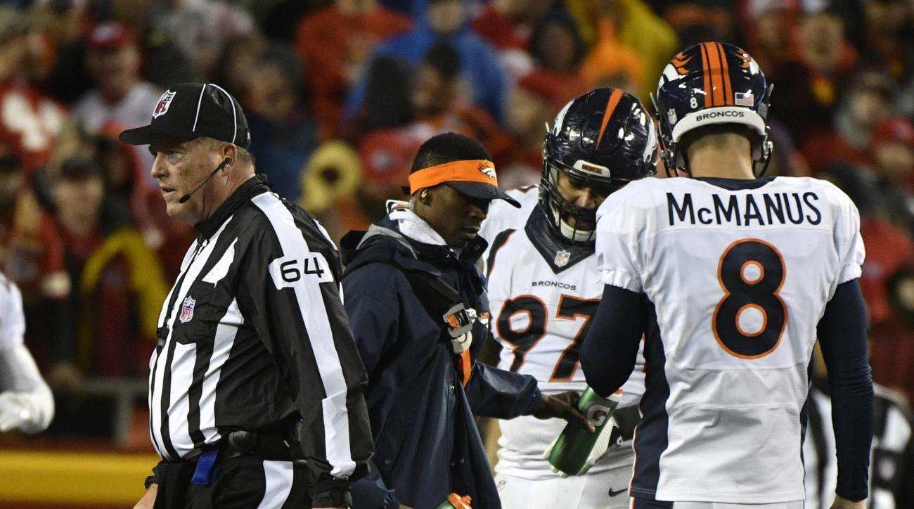 Denver Broncos cornerback Kayvon Webster (36) lies injured on the field during the first half of an NFL football game against the Kansas City Chiefs in Kansas City, Mo., Sunday, Dec. 25, 2016. (AP Photo/Ed Zurga)
