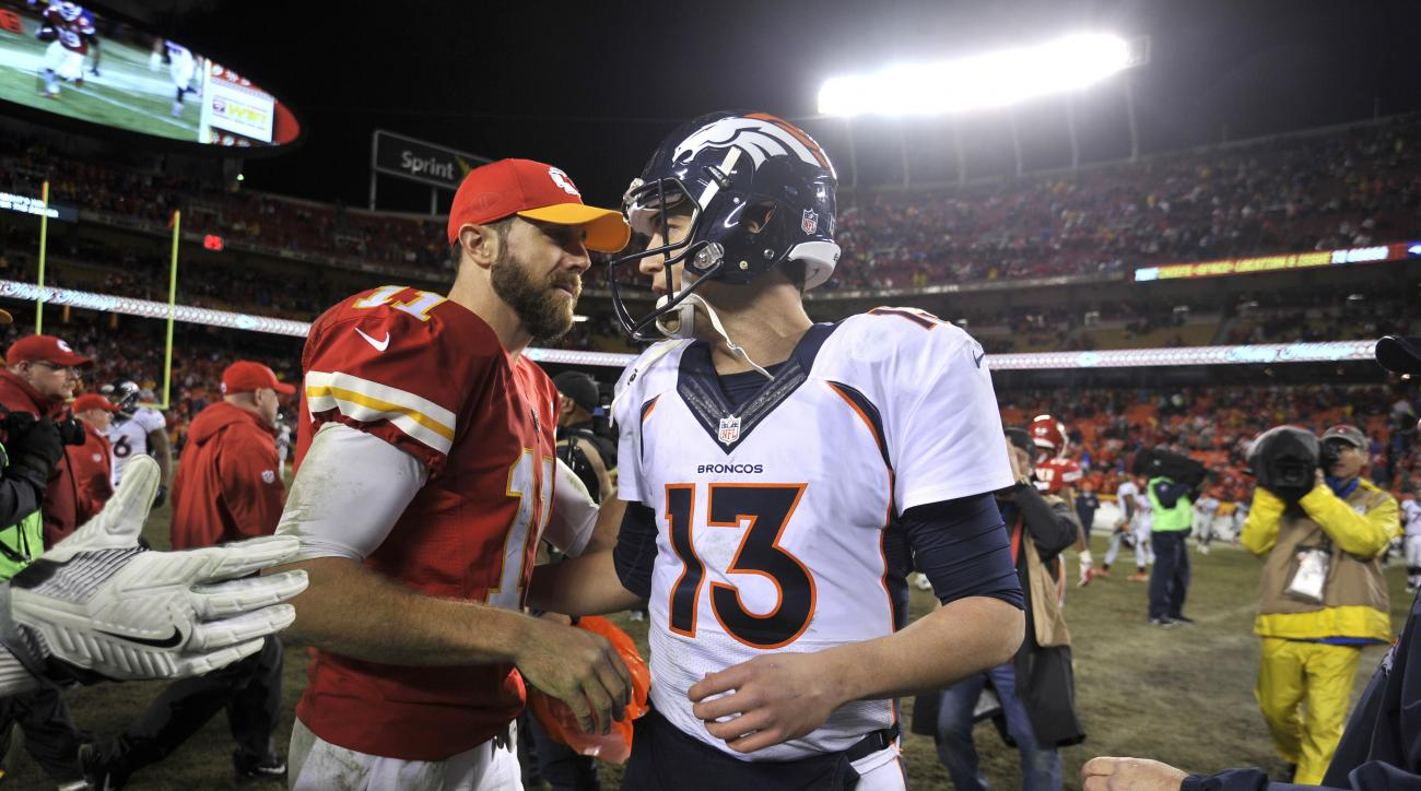 Kansas City Chiefs quarterback Alex Smith (11) and Denver Broncos quarterback Trevor Siemian (13) meet following an NFL football game in Kansas City, Mo., Sunday, Dec. 25, 2016. The Chiefs won 33-10. (AP Photo/Ed Zurga)