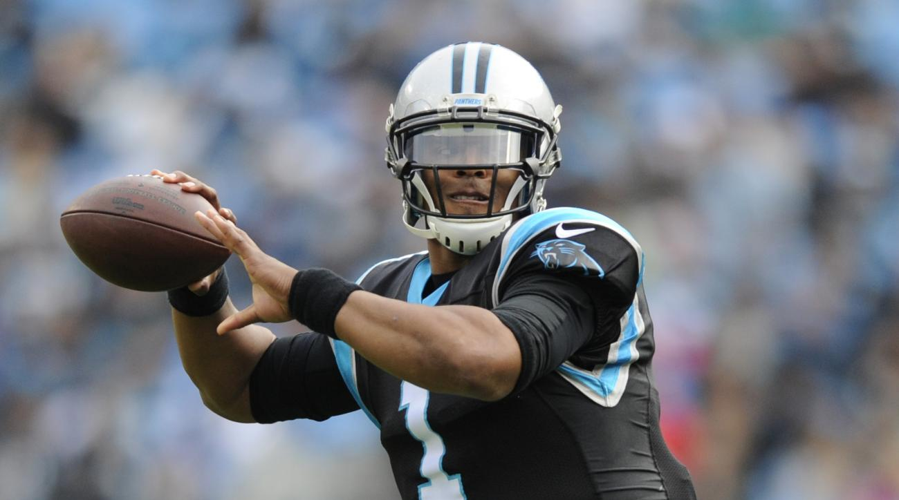 FILE - In a Saturday, Dec. 24, 2016 file photo, Carolina Panthers' Cam Newton (1) looks to pass against the Atlanta Falcons in the first half of an NFL football game in Charlotte, N.C. One year after throwing 35 touchdowns and 10 interceptions, Newton has
