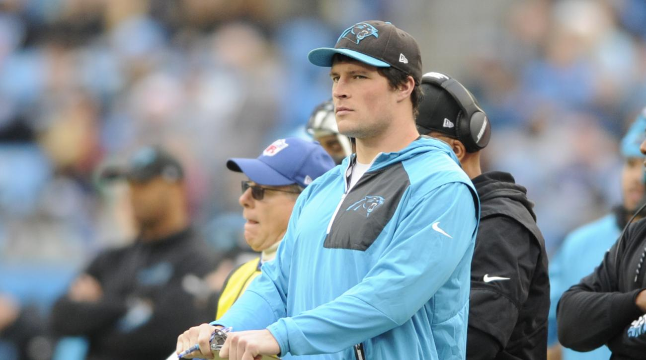 FILE - In a Saturday, Dec. 24, 2016 file photo, Carolina Panthers' Luke Kuechly watches from the sidelines in the second half of an NFL football game against the Atlanta Falcons in Charlotte, N.C. Injuries played a role in Carolinas demise this season, pa
