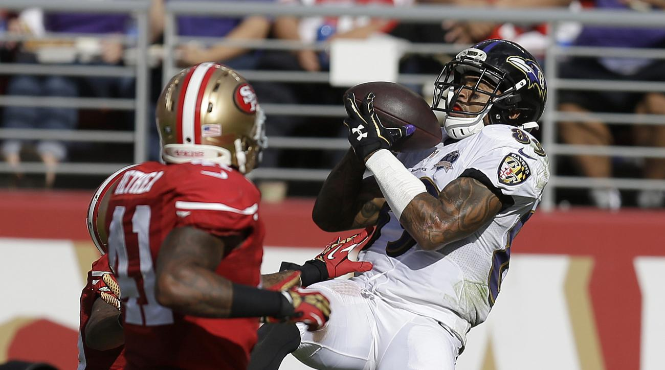 FILE - In this Oct. 18, 2015, file photo, Baltimore Ravens wide receiver Steve Smith (89) catches a 34-yard touchdown pass in front of San Francisco 49ers strong safety Antoine Bethea (41) and cornerback Kenneth Acker during the second half of an NFL foot