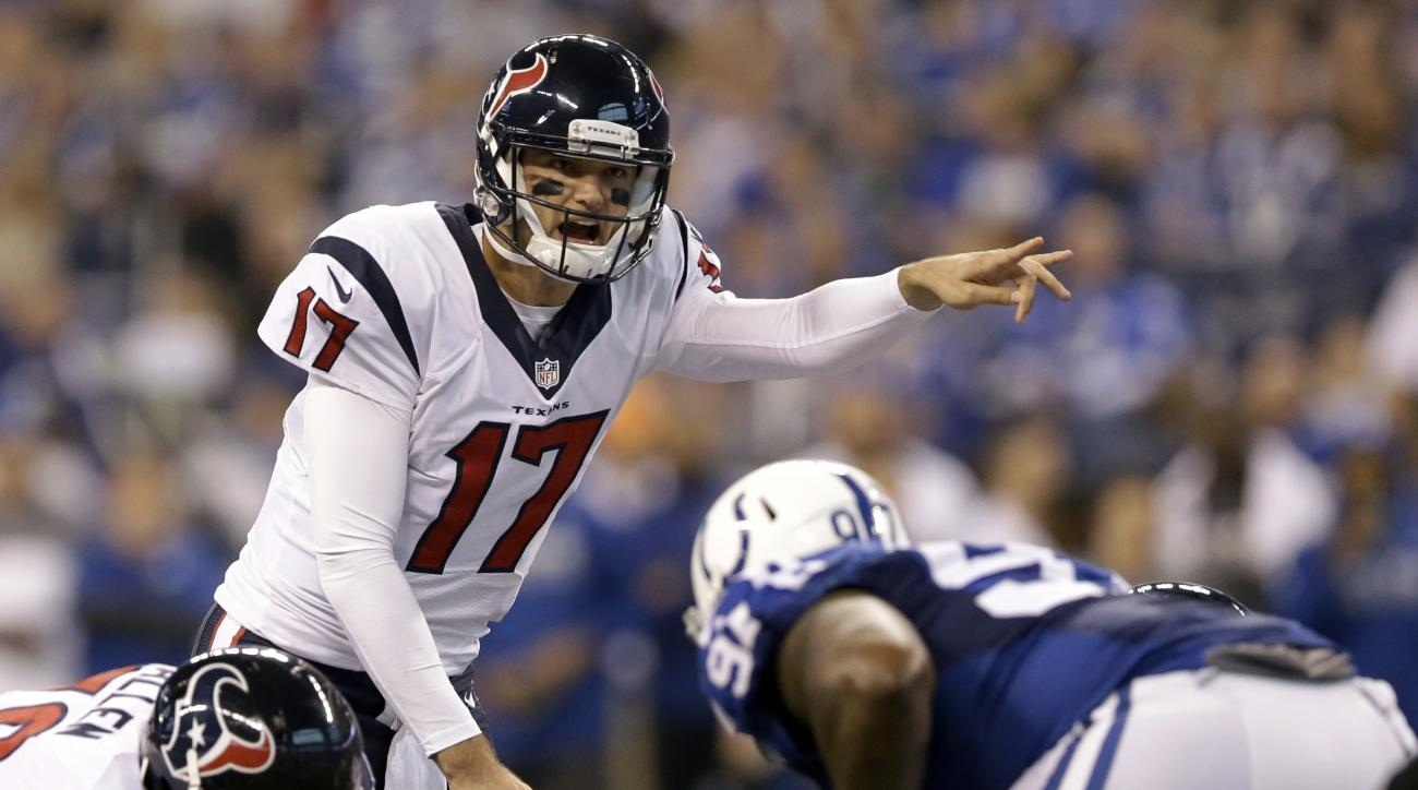 FILE - In a Sunday, Dec. 11, 2016 file photo, Houston Texans quarterback Brock Osweiler yells on the line of scrimmage during the first half of an NFL football game against the Indianapolis Colts, in Indianapolis. Among the worst calls of the 2016 NFL sea