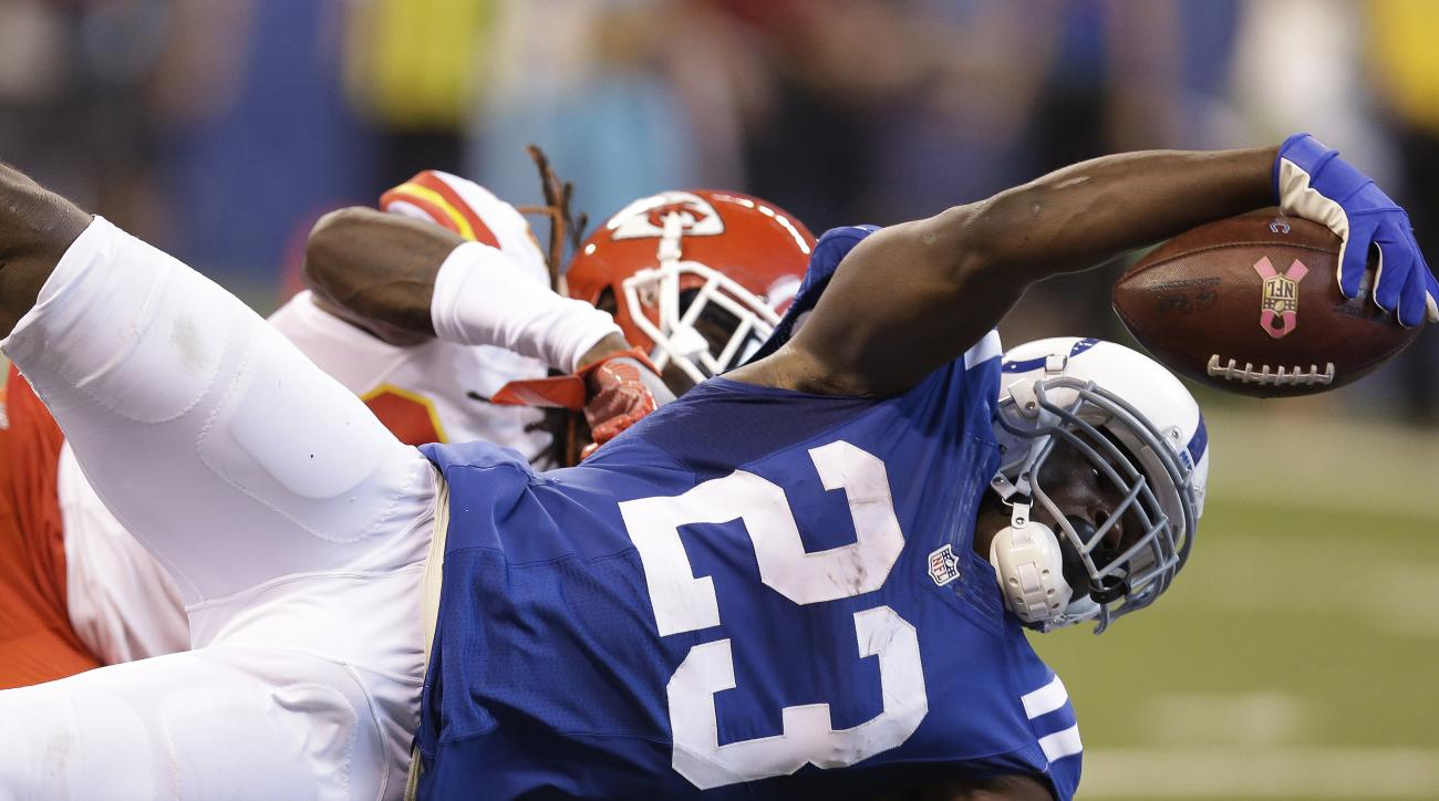 FILE - In this Oct. 30, 2016, file photo, Indianapolis Colts' Frank Gore (23) dives for a 18-yard touchdown reception against Kansas City Chiefs' Ron Parker during the first half of an NFL football game, in Indianapolis. Thirty three-year-old running back