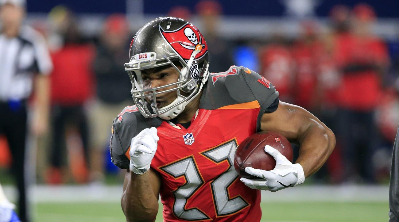 This Dec. 18, 2016 photo shows Tampa Bay Buccaneers' Doug Martin (22) carrying the ball in the first half of an NFL football game against the Dallas Cowboys in Arlington, Texas. Martin has been suspended four games for violating the NFL's policy on perfor