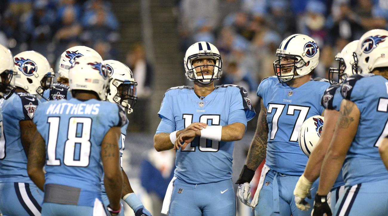 FILE - In this Oct. 27, 2016, file photo, Tennessee Titans quarterback Matt Cassel (16) huddles with teammates during an NFL football game against the Jacksonville Jaguars in Nashville, Tenn. With starting quarterback Marcus Mariota out with a broken righ