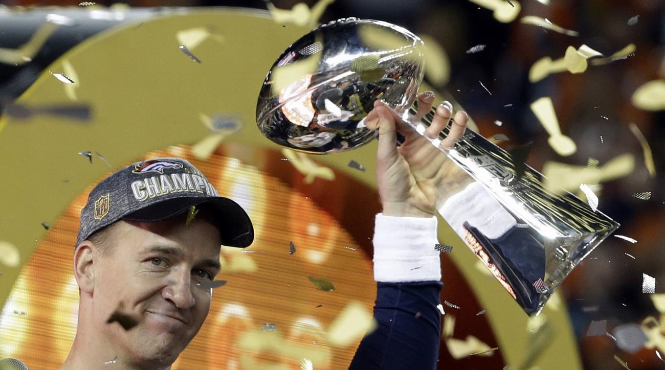 FILE - In this Feb. 7, 2016, file photo, Denver Broncos quarterback Peyton Manning holds up the Vince Lombardi Trophy after the Broncos defeated the Carolina Panthers 24-10 in NFL football's Super Bowl 50 in Santa Clara, Calif. Manning announced his retir