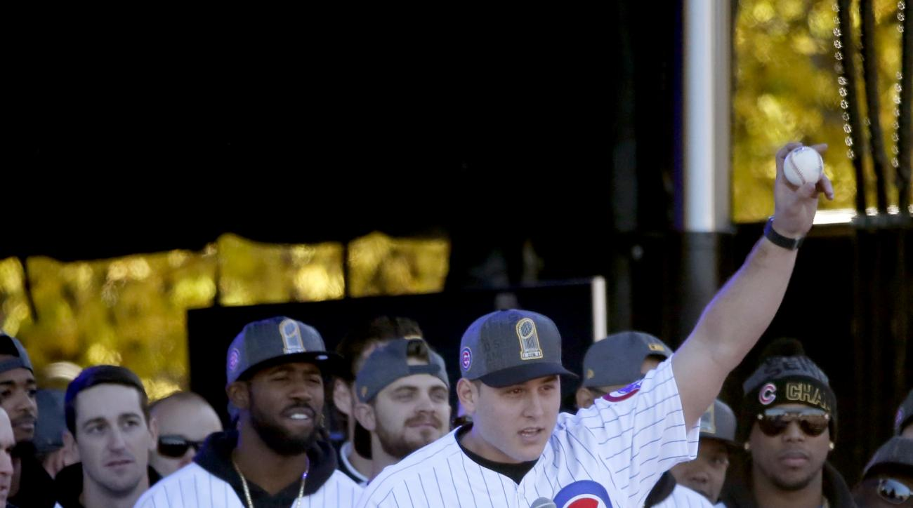 FILE - In a Friday, Nov. 4, 2016 file photo, Chicago Cubs' Anthony Rizzo holds up the World Series final out ball during a rally in Grant Park honoring the World Series baseball champions, in Chicago. (AP Photo/Charles Rex Arbogast, File)