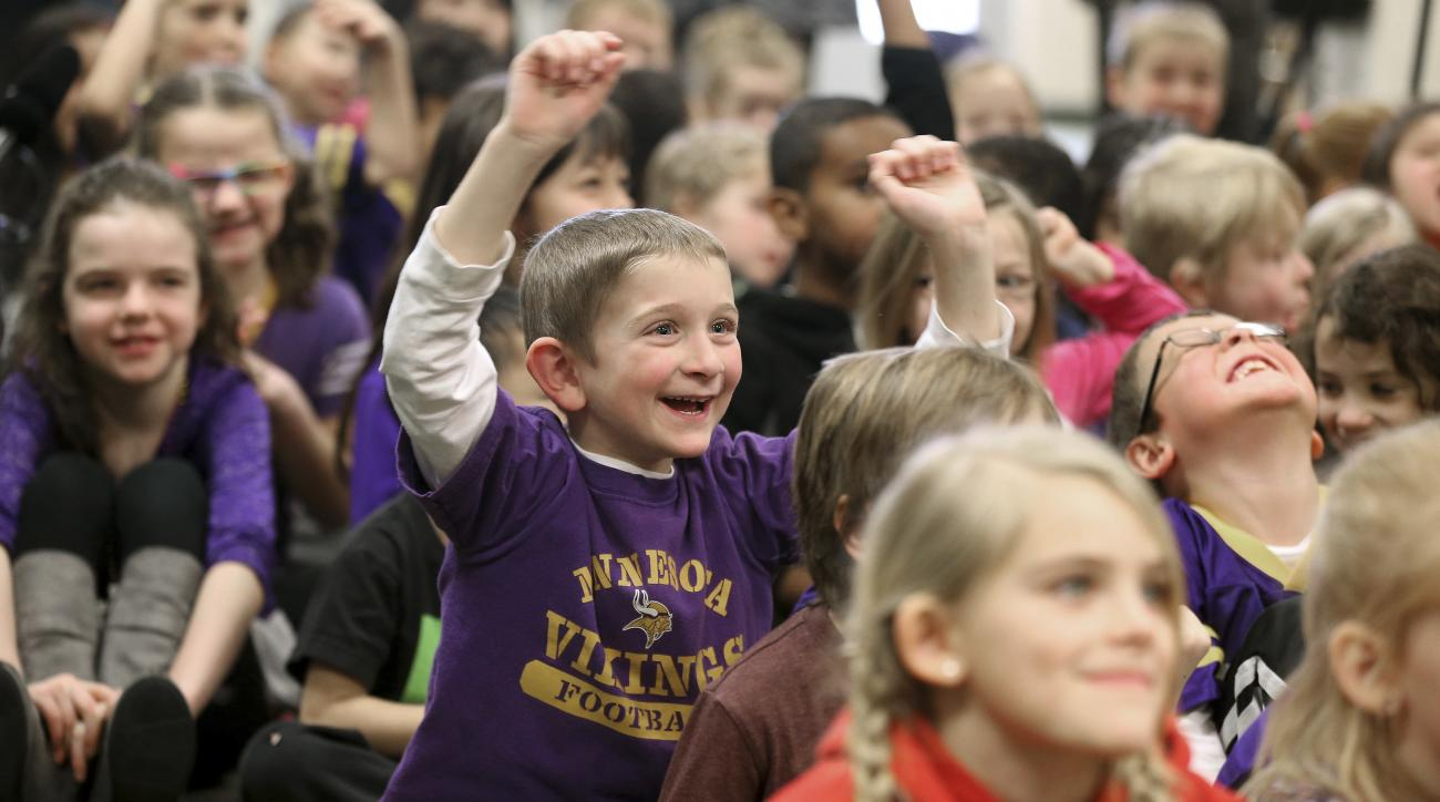 FILE - In this Jan. 14, 2016 file photo, first grader Cody Rudoy smiles with excitement as Minnesota Vikings kicker Blair Walsh thanks first graders at Northpoint Elementary School for writing letters of encouragement to him after he missed a 27-yard fiel