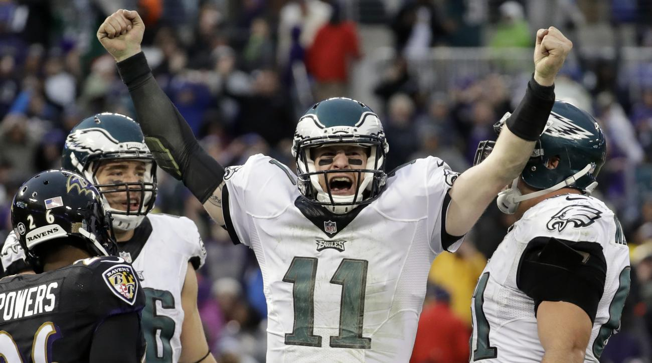FILE - In a Sunday, Dec. 18, 2016 file photo, Philadelphia Eagles quarterback Carson Wentz (11) celebrates his touchdown during the second half of an NFL football game against the Baltimore Ravens in Baltimore. Wentz, the No. 2 overall pick, is second beh