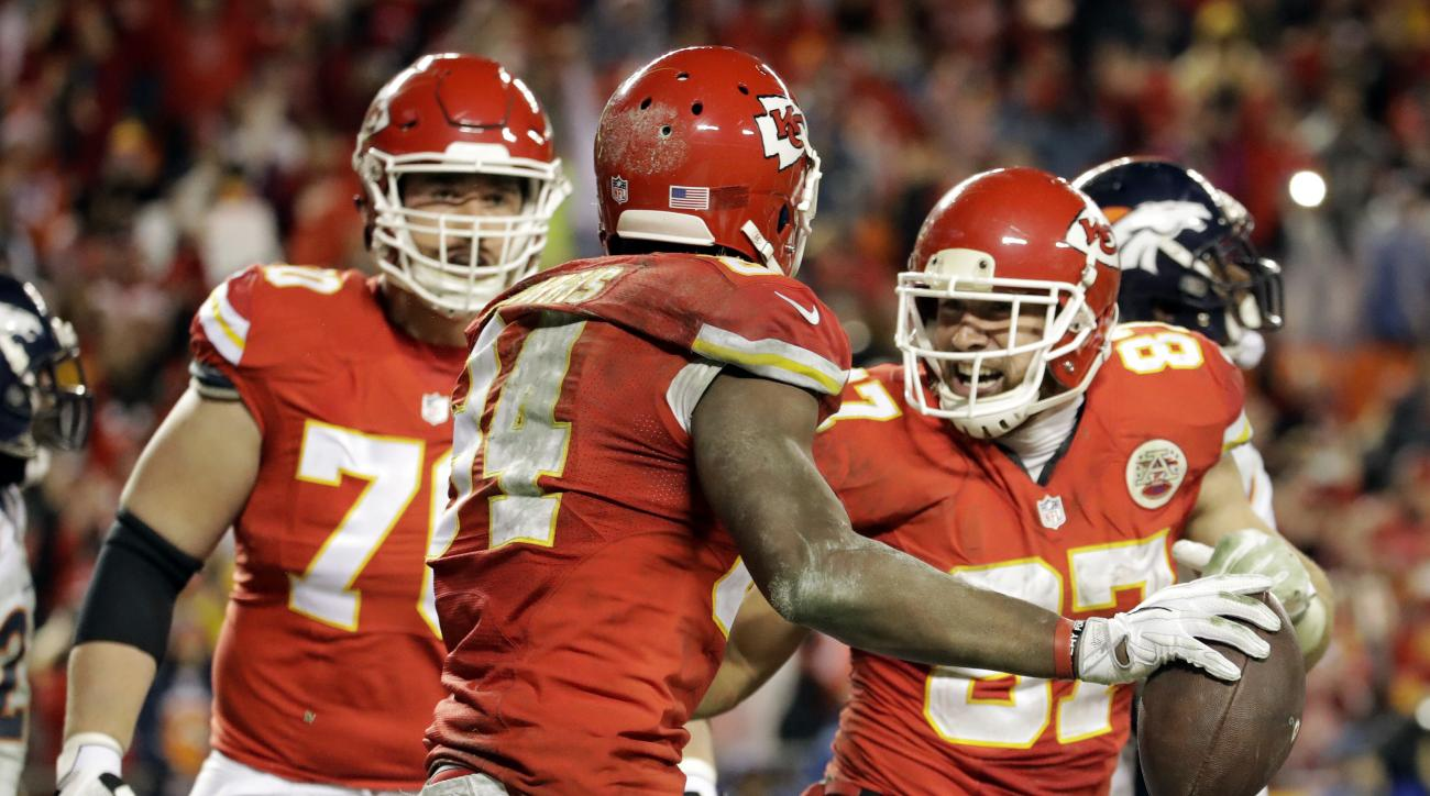 FILE - In a Dec. 25, 2016 file photo, Kansas City Chiefs tight end Travis Kelce, right, celebrates with tight end Demetrius Harris (84), after Harris caught a touchdown pass against the Denver Broncos during the second half of an NFL football game in Kans