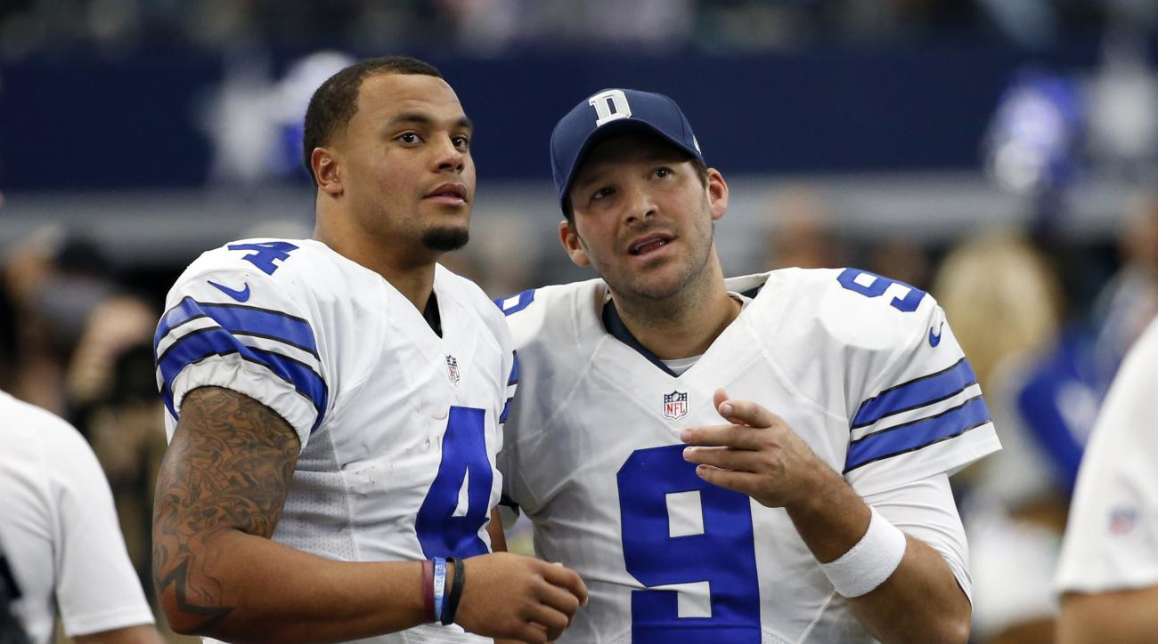 FILE - In a Sunday, Nov. 20, 2016 file photo, Dallas Cowboys' Dak Prescott (4) and Tony Romo (9) talk on the sideline in the first half of an NFL football game against the Baltimore Ravens in Arlington, Texas. The Cowboys went on a record-setting run with