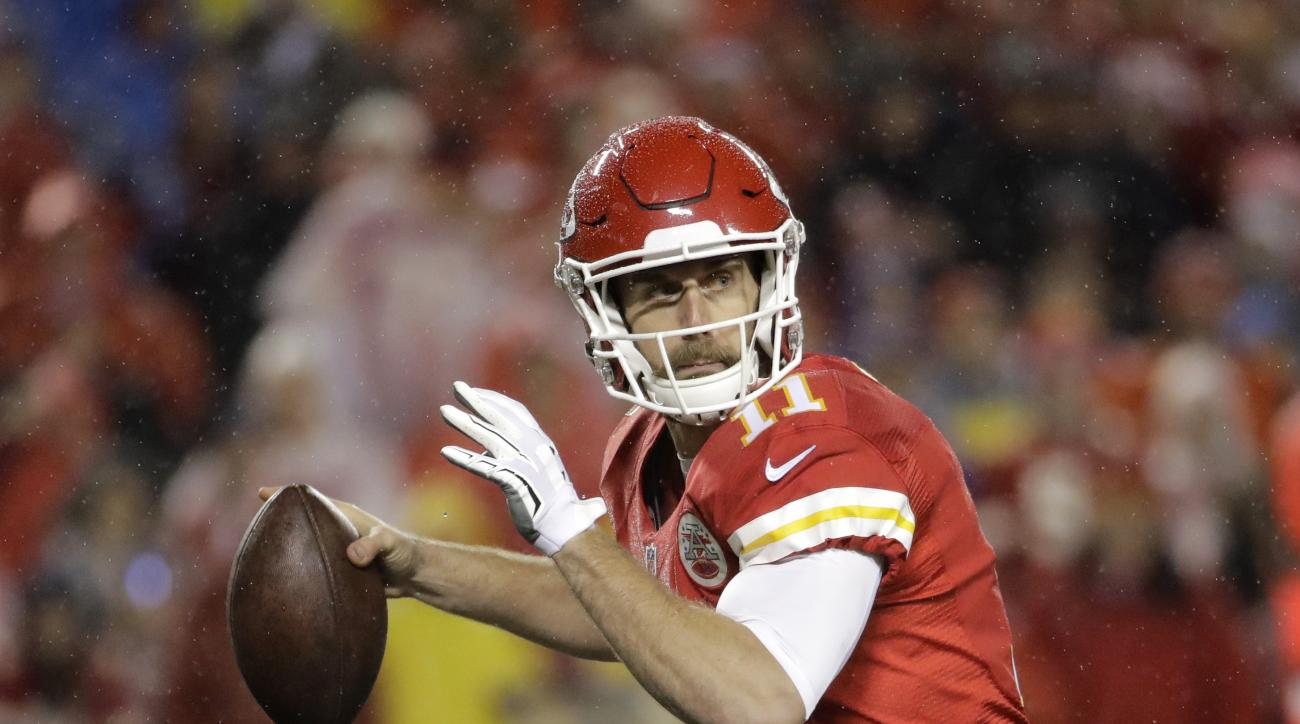 FILE -  In this Sunday, Dec. 25, 2016 file photo, Kansas City Chiefs quarterback Alex Smith (11) throws during the first half of an NFL football game against the Denver Broncos in Kansas City, Mo. What totally different experiences the Kansas City Chiefs