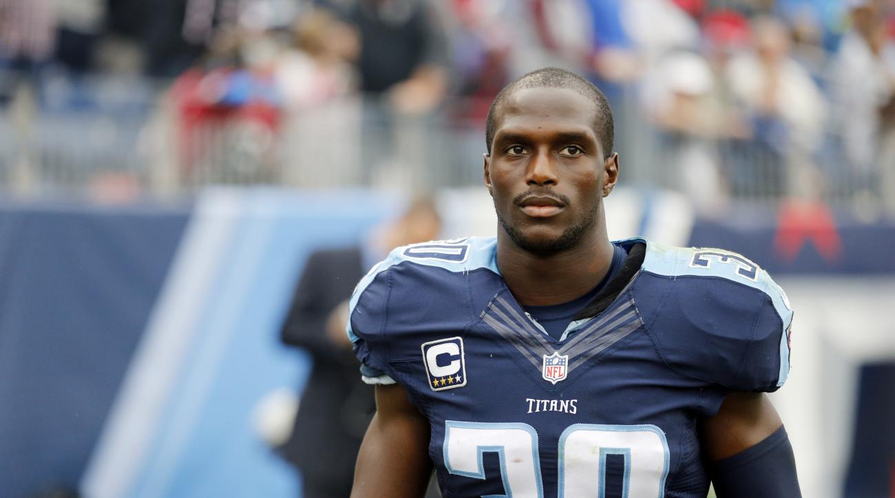 FILE - In this Oct. 25, 2015, file photo, Tennessee Titans cornerback Jason McCourty walks on the sideline in the second half of an NFL football game against the Atlanta Falcons in Nashville, Tenn. McCourty helped hold Texans wide receiver DeAndre Hopkins