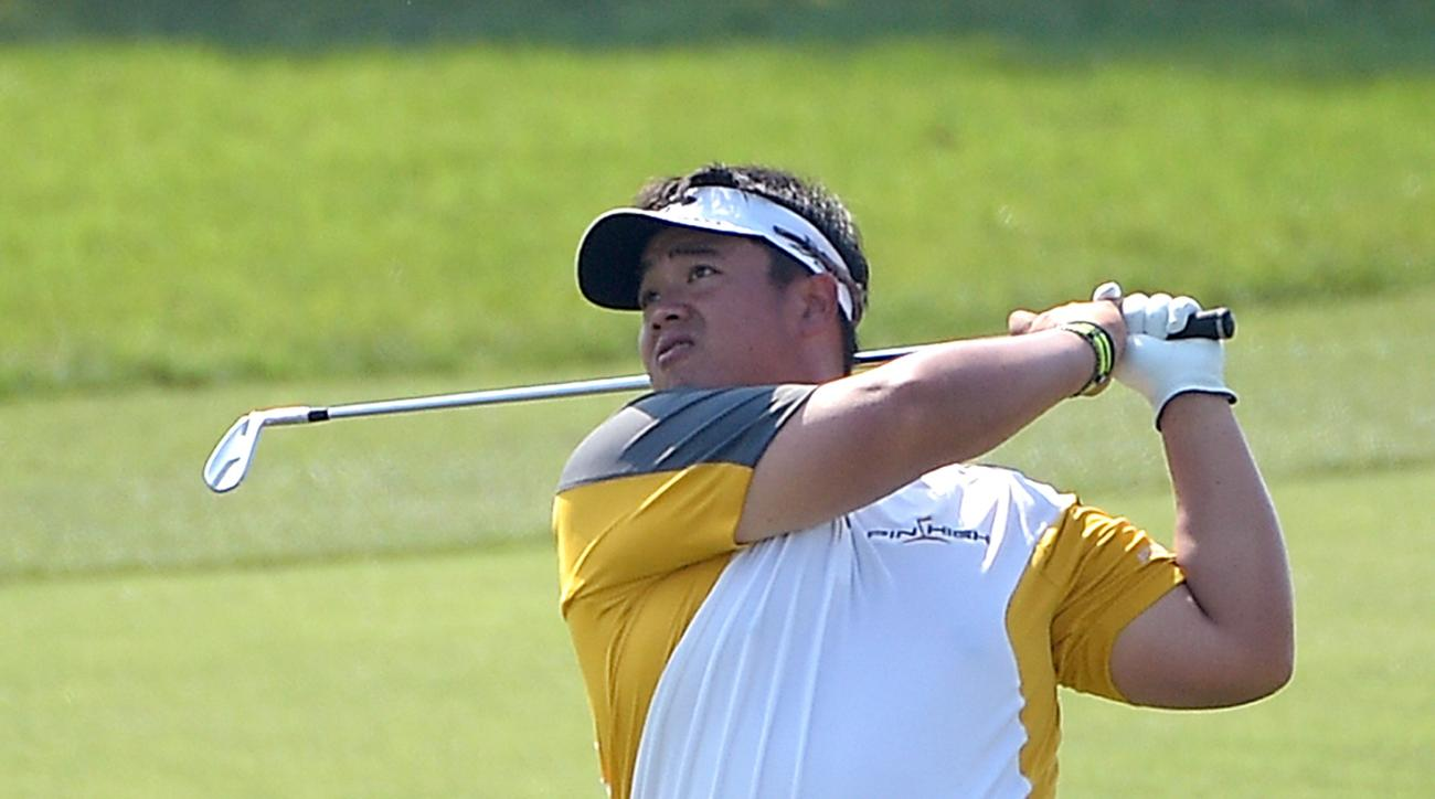 Kiradech Aphibarnrat, of Thailand, watches his shot from the 18th fairway during the second round of the Arnold Palmer Invitational golf tournament in Orlando, Fla., Friday, March 20, 2015.(AP Photo/Phelan M. Ebenhack)