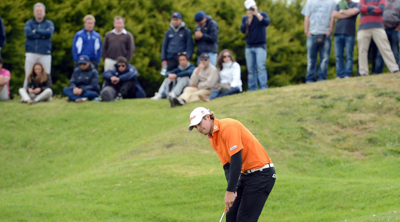 Peter Uihlein, of the US, putts from the edge of the 18th hole during the last round of the Madeira Islands Open Sunday, May 19 2013, at the Santo da Serra golf course, in Machico, Portugal. Uihlein shot a 15-under-par total of 273 to win the tournament.
