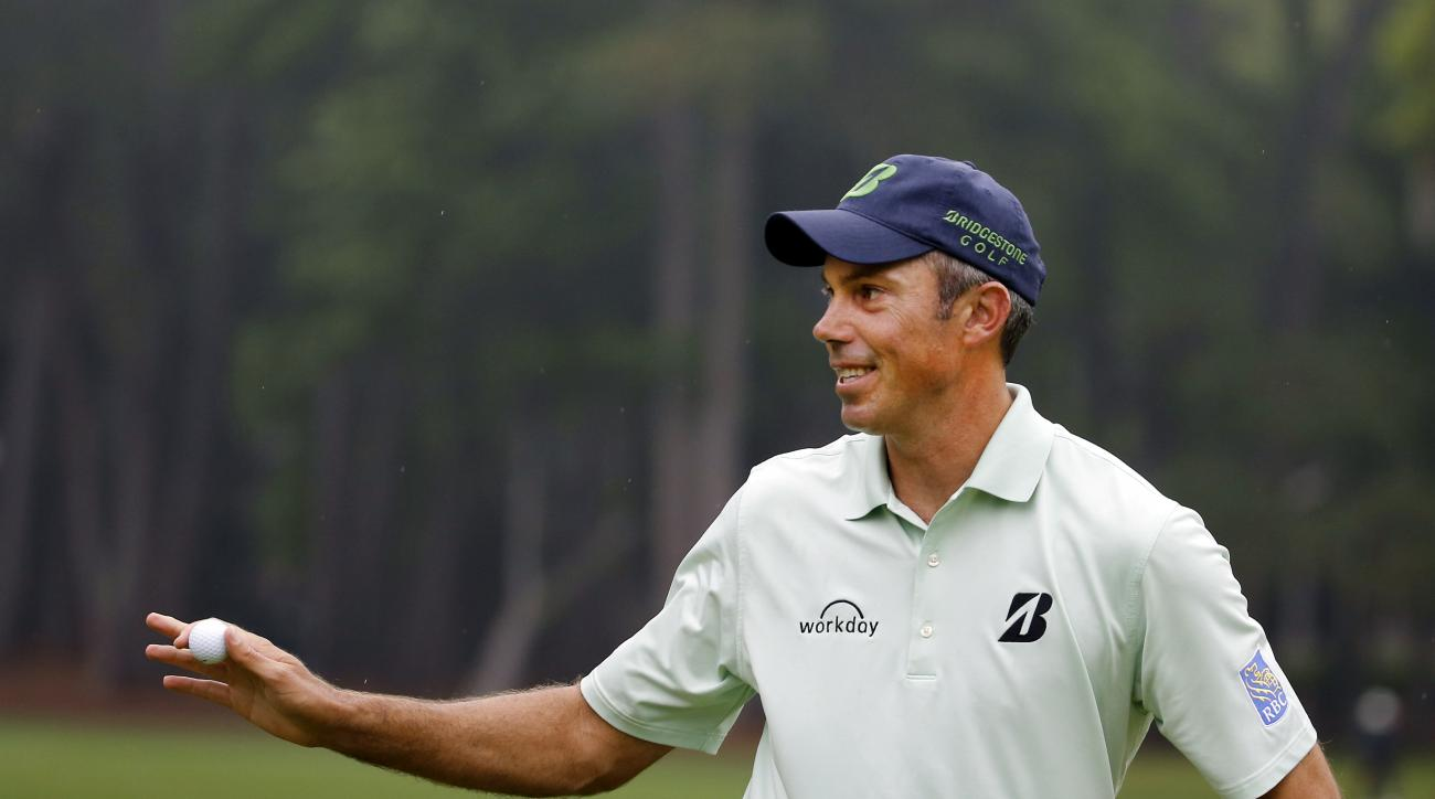 Matt Kuchar waves his ball at the crowd on the second green after making birdie putt during the final round of the RBC Heritage golf tournament in Hilton Head Island, S.C., Sunday, April 19, 2015. (AP Photo/Stephen B. Morton)