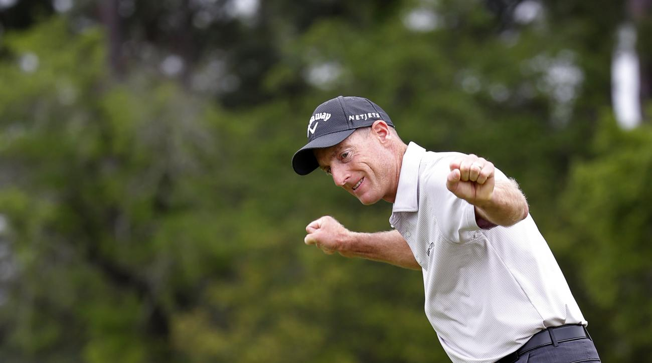 Jim Furyk reacts before sinking his winning putt on the 17th hole against Kevin Kisner during the playoff of the RBC Heritage golf tournament in Hilton Head Island, S.C., Sunday, April 19, 2015. (AP Photo/Stephen B. Morton)