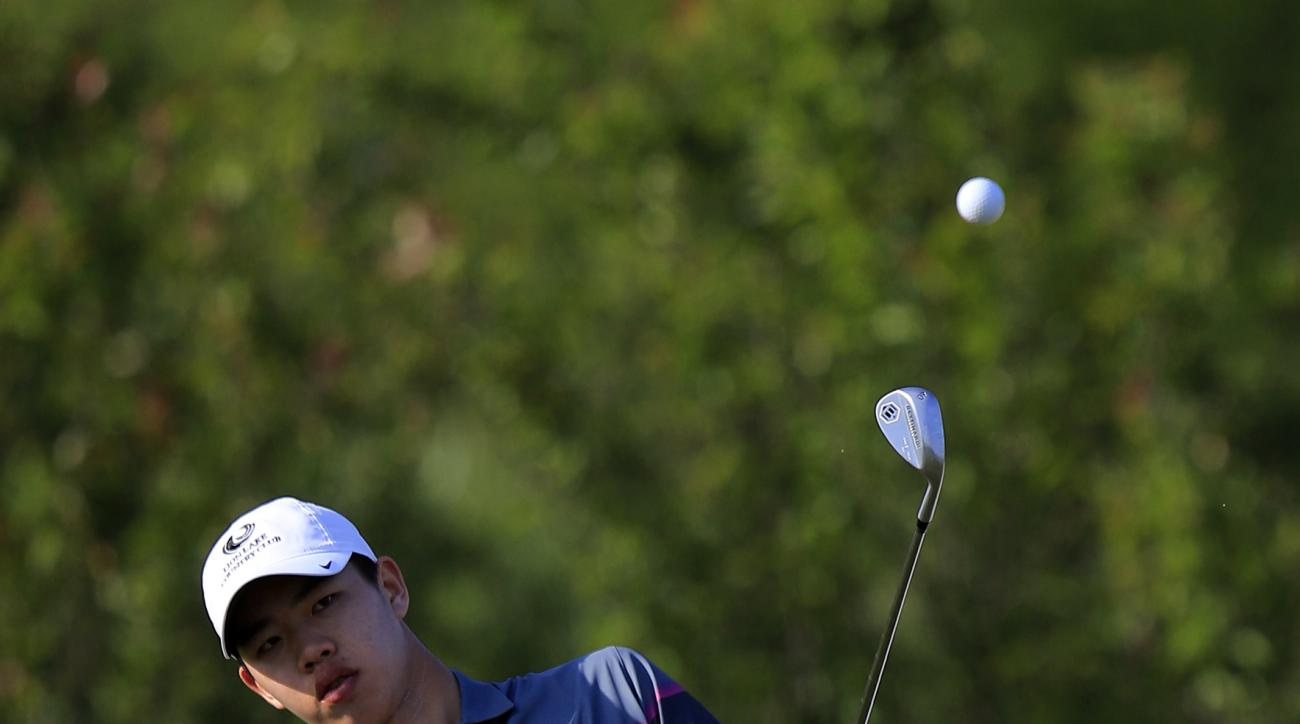 Guan Tianlang of China plays off the 11th tee during the first round of the Volvo China Open in Shanghai, China Thursday April 23, 2015. (AP Photo)