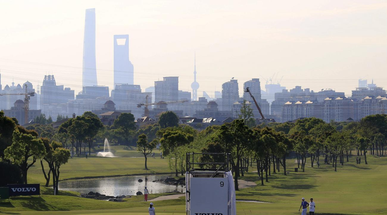 A view of the 9th green with the city skyline in the background during the first round of the Volvo China Open in Shanghai, China Thursday April 23, 2015. (AP Photo)