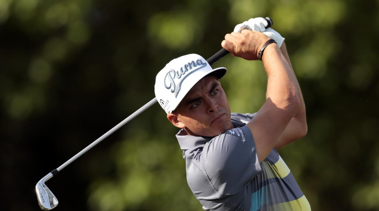 Rickie Fowler watches his tee shot on the 14th hole during the first round of the Zurich Classic PGA golf tournament, Thursday, April 23, 2015, in Avondale, La (AP Photo/Butch Dill)