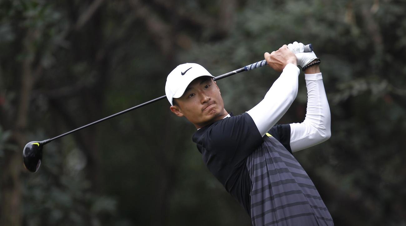 FILE - In this Nov. 9, 2014 file photo, Li Haotong of China tees off on the 11th hole during the final round of the HSBC Champions golf tournament at the Sheshan International Golf Club in Shanghai, China. Li Haotong is one of the most exciting prospects