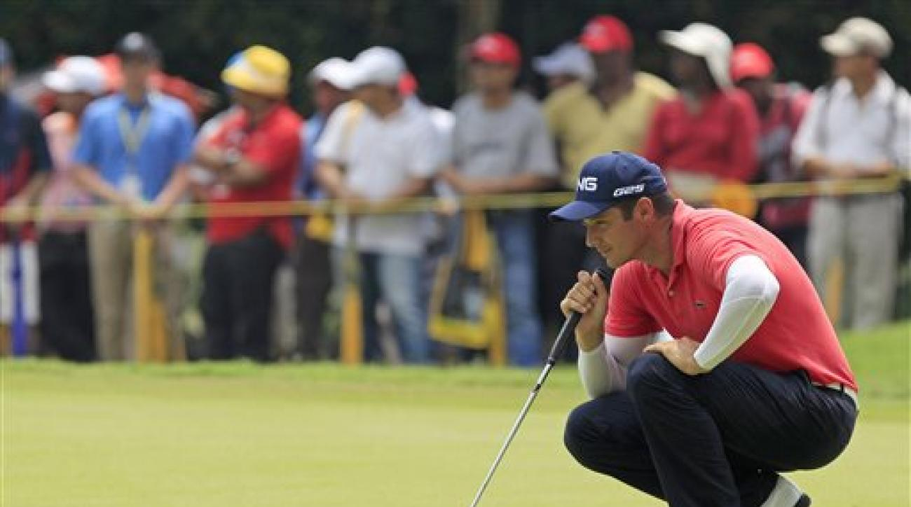 Julien Quesne of France lines up his putt on the ninth green during the final round of the Malaysian Open golf tournament at Kuala Lumpur Golf and Country Club in Kuala Lumpur, Malaysia, Sunday, April 20, 2014. (AP Photo/Lai Seng Sin)