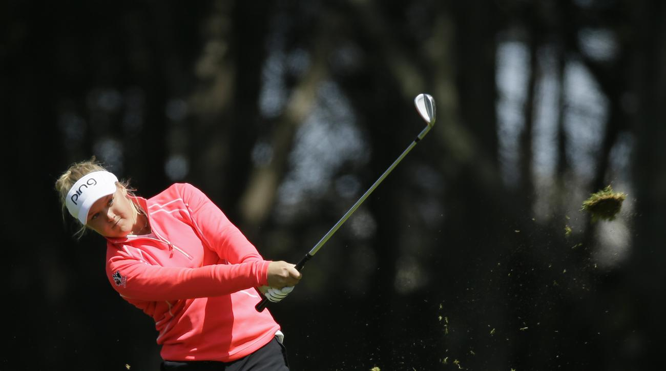 Brooke Henderson, of Canada, hits her approach shot from the fairway to the ninth green of the Lake Merced Golf Club during the second round of the Swinging Skirts LPGA Classic golf tournament Friday, April 24, 2015, in Daly City, Calif. (AP Photo/Eric Ri